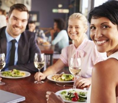 Group of business people at lunch in a restaurant